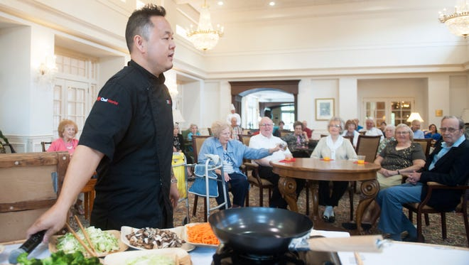 Celebrity chef Jet Tila visits The Evergreens retirement community In Moorestown to do a meet-and-greet and a cooking demonstration for residents.