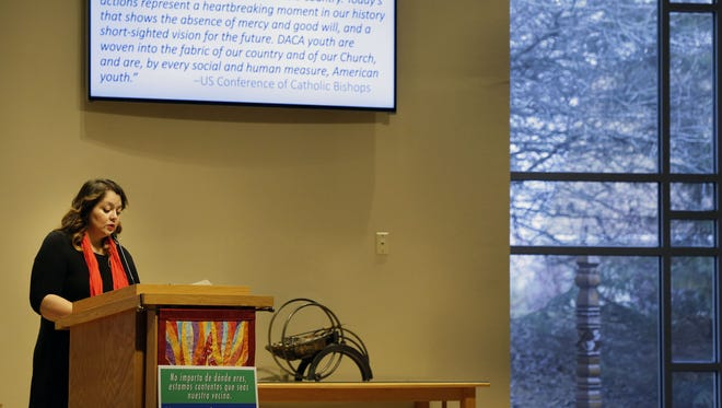 Norys Pina, a volunteer leader of Unidos Por Un Futuro Mejor (United for a Better Future), reads letters from two DREAMers during a program on the Deferred Action for Childhood Arrivals (DACA) program Sunday at Fox Valley Unitarian Universalist Fellowship in Appleton. The screen behind her displays a statement from the U.S. Conference of Catholic Bishops regarding DACA.