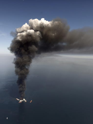 Smoke rises from BP?s Deepwater Horizon offshore oil rig after an explosion in April  2010 that spilled crude oil into the Gulf of Mexico.