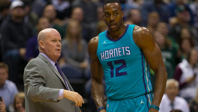 Charlotte Hornets head coach Steve Clifford talks with center Dwight Howard (12) during the first quarter against the Milwaukee Bucks at BMO Harris Bradley Center.