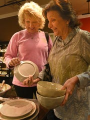 Sheryl Little (left) and Tina Calligas check out the dishes at Lewis' Gifts.