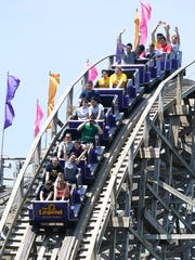 Guests riding the Legend rollercoaster at Holiday World Wednesday, May 10, 2017.