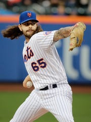 New York Mets' Robert Gsellman (65) delivers a pitch during the first inning of a baseball game against the San Diego Padres, Wednesday, May 24, 2017, in New York.