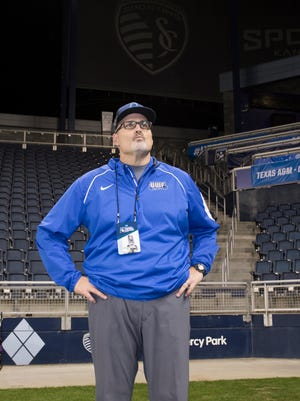 Head coach Shinnick watches as the Lions celebrate after the University of West Florida 37-27 loss to Texas A&M - Commerce in the NCAA Division II National Championship football game at Children's Mercy Park in Kansas City, Kansas on Saturday, December 16, 2017.