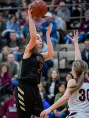 Webster County's Karlie Keeney (3) looks to pass over