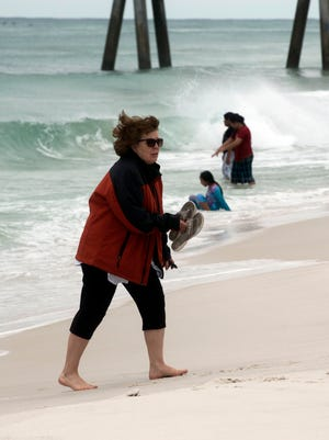 Joselyn Reeder and her family visit Pensacola Beach while on spring break Wednesday, April 4, 2018. According to recently released numbers, Pensacola Beach saw an increase in visitors over last year during the same period.