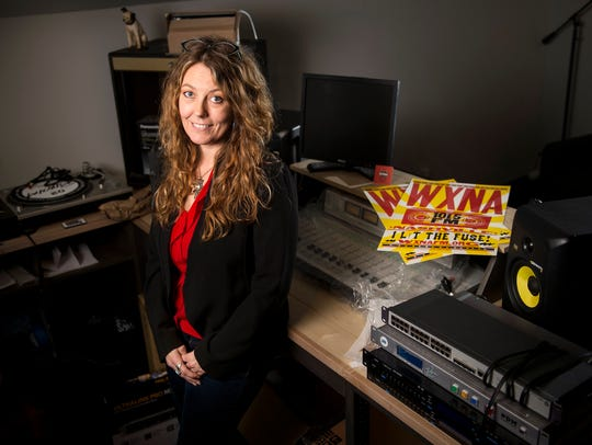 Heather Lose poses for a portrait in the WXNA studio