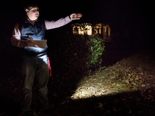"""Tour guide Brandon Burvee, of Bolivar, tells stories to attendees Saturday, Oct. 28, 2017, during Epic Haunted Tours' """"History, Legends & Maybe Some Ghosts Tour"""" in Bolivar."""