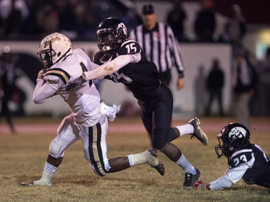 Springfield's Travion Woodard is tackled by South Side's Devin Bowers on Friday, Nov. 17, 2107, during Springfield's 23-22 victory over South Side at South Side High School.