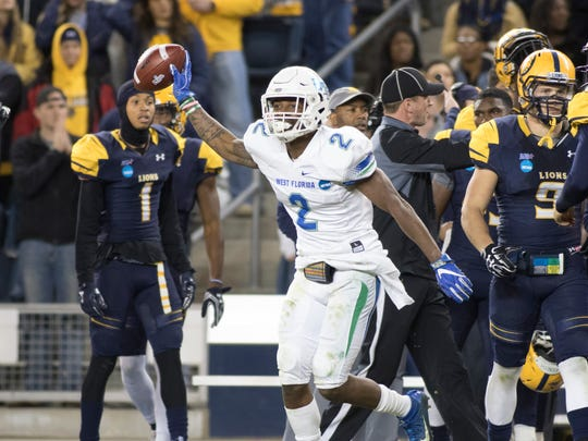 Andre Duncombe (2) celebrates after intercepting a Lions pass during the University of West Florida vs Texas A&M - Commerce NCAA Division II National Championship football game at Children's Mercy Park in Kansas City, Kansas on Saturday, December 16, 2017.