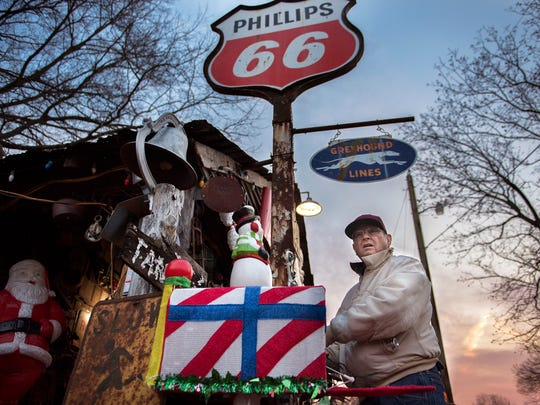 Staley Holder, of Pinson, looks toward the highway while checking his Christmas lights are working Wednesday, Dec. 13, 2017, at his shed at the corner of Circle Drive and US-45 in Pinson.