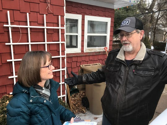 "Democratic activist Colleen Hartung talks to Ronald Stucki as she goes door to door in Madison for a Dane County Board candidate. Hartung helped start a neighborhood team of party volunteers in Sun Prairie and was part of many volunteer ""phone banks"" to urge Democrats in western Wisconsin to vote in the party's recent upset victory in the 10th State Senate District."