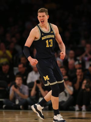 Michigan forward Moritz Wagner reacts after a basket against Michigan State during the second half Saturday.