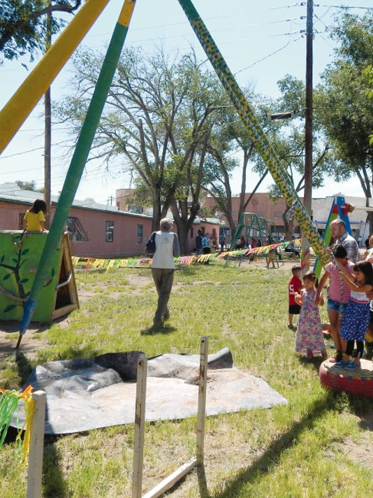Kids line up to swing aross the mud puddle in the obstacle course made by Carrizozo resident Mike Lagg.