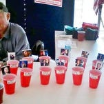 Bob Norton of Little Suamico mans the presidential straw poll at the Republican Party of Oconto County booth at the county fair in Gillett.