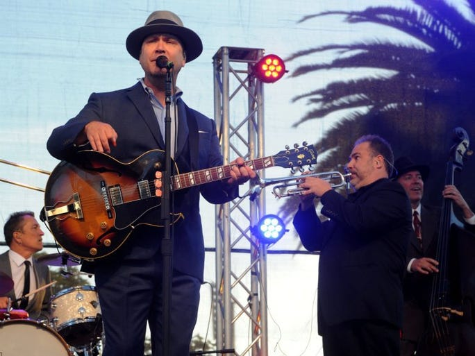JUAN CARLO/THE STAR Scotty Morris with local band Big Bad Voodoo Daddy performs at Mission Park in downtown Ventura in a concert to celebrate the city's 150th birthday.