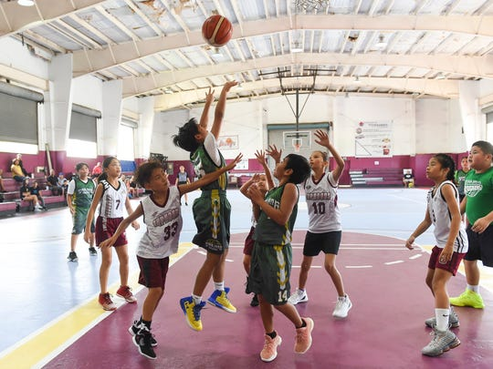 The Sinajana Rockets took on the Tamuning Typhoons in the Bank of Guam SummerJam Basketball Tournament at Tamuning Gym in this July 8, 2018, file photo.