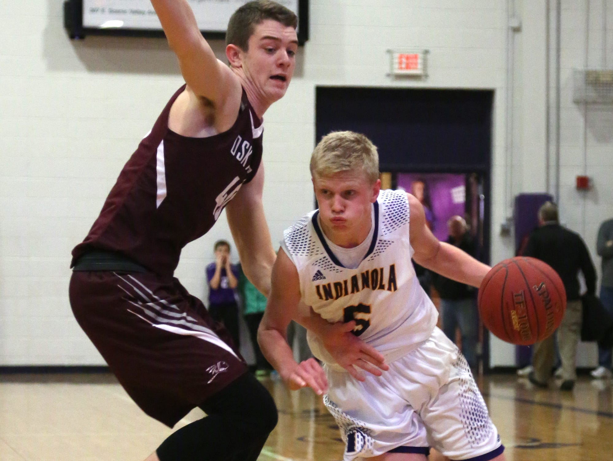 Indianola sophomore Quinn Vesey tries to get around Oskaloosa sophomore Cole Henry. Oskaloosa edged Indianola 65-60 in a Jan. 13 game in Indianola.