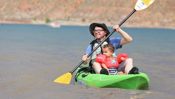 Outdoors writer Brian Passey kayaks with his nephew,