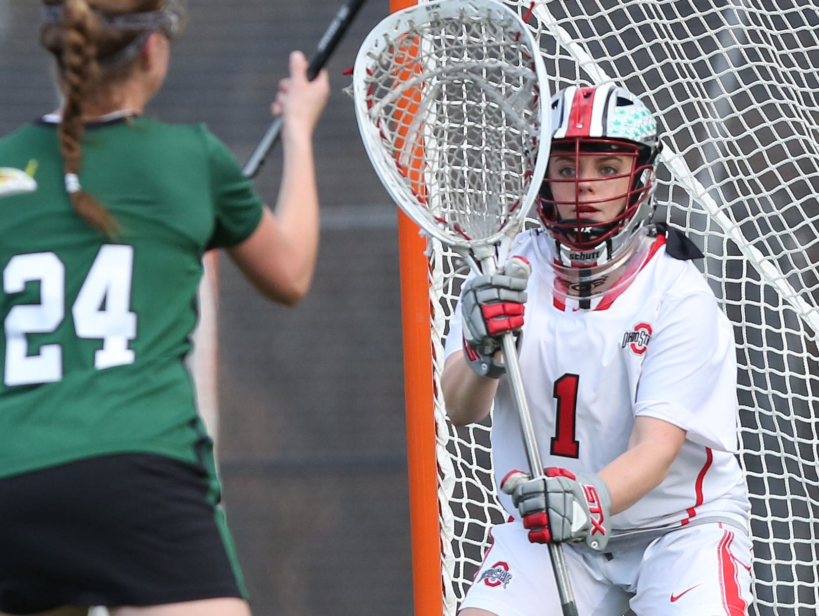 From right, Ohio State goalie Katie Frederick (1) gets ready for a shot from Binghamton's Rebecca Golderman (24) at Yorktown High School March 25, 2016. Ohio State won the game 10-5. Frederick is a graduate of Yorktown High School.
