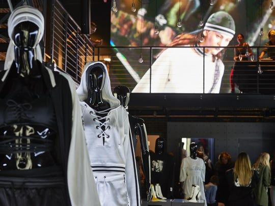 Invited customers look over the Fenty Puma by Rihanna