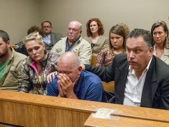 Family and friends of Kenneth White, including his father Kenny White, front row center, attend the arraignment of five teens on Oct. 24, 2017, in 67th District Court in Flint. Kenneth White was killed after a rock was thrown from an overpass and struck him as he was riding in a vehicle in Vienna Township.