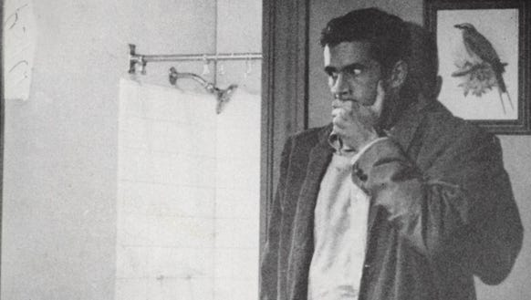 Norman Bates (Anthony Perkins) freaks out in a scene