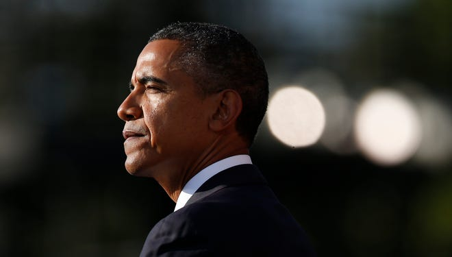 President Obama speaks at a memorial service for the victims of the Washington Navy Yard shooting. He leaves for the United Nations General Assembly on Monday.