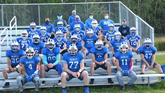 The Brimley varsity and JV football teams include, front row, from left: Mason Harris, Brandon Pomeroy and Gary LaPine; second row, from left: Dominic Morrison, John Stenglein, Grady Newland and Colin Hopper; third row, from left: Alec Hill, Aiden Beseau and Caleb Lipponen; fourth row, from left: Charley Lyons, Zach Ennes, Willie Caldwell and Landon Cameron; fifth row, from left: Owen Johnson, Kenneth VanderMeer, Logan Peake; sixth row, from left: Gavin Beseau, Donovan Murphy, Perry LeBlanc and Parker Veneman; seventh row, from left: coach Bob Cameron,  coach Kevin Murphy, coach Austin Kronemeyer; eighth row, from left: coach Terry Maguran, coach Garrett Johnson; ninth row: varsity head coach Tom McKee. Missing from photo: coaches Derek Beseau and Brian Reattoir.