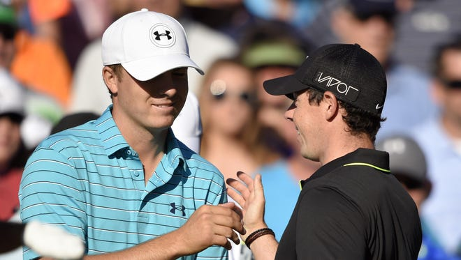Jordan Spieth (left) has won both majors this season, but Rory McIlroy (right) is still ranked No. 1. They'll be paired with Zach Johnson for the first two rounds of the PGA Championship next week at Whistling Straits.