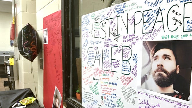 Signs honoring Caleb Simpson were placed in the halls of Winton Woods High School Friday after Simpson drown in Winton Lake.