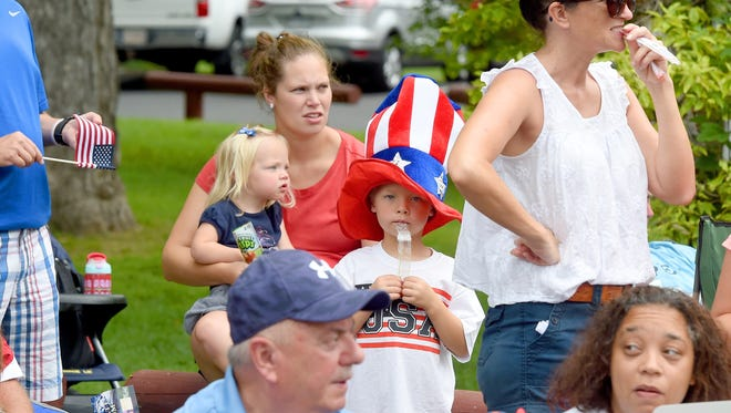 Attendees watch the Fourth of July parade in Gypsy Hill Park on Tuesday morning.