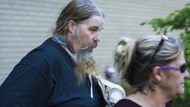 Bernard Savage Sr. leaves the U.S. District Court in Burlington with his wife, Patty, following a hearing last month.
