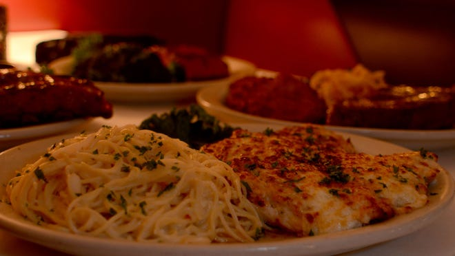 The parmesan-crusted chicken with angel hair pasta at Maury's Tiny Cove.