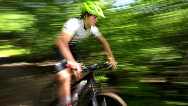 Simon Lewis, 16, rides his mountain bike at Percy Warner Park in Nashville. He will compete in a national mountain bike race in California this week.