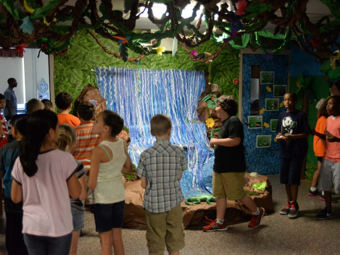 Students at Rieck Avenue School in Millville walk by a waterfall in a simulated tropical rainforest as part of a school project on Wednesday, June 18, 2014.  Staff photo/Charles J. Olson