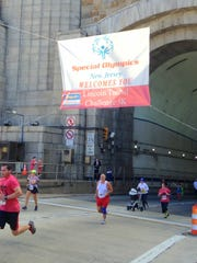 Santiago Sports Chiropractic team member Rocco Scarano reaches New York City after running through the Lincoln Tunnel.