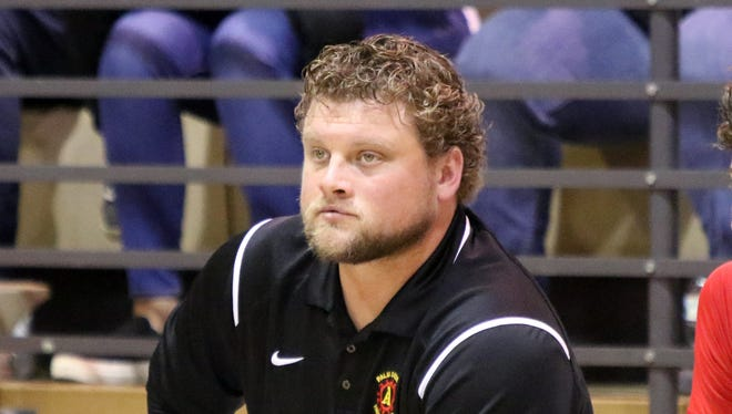 Patrick Rivenes, shown here with the Palm Desert boys' basketball team, has been hired to coach the La Quinta football team.
