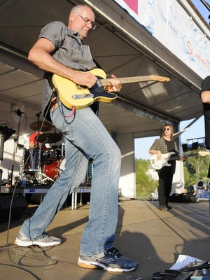 """Paul """"Stretch"""" Diethelm of the Fabulous Armadillos plays guitar last August at a Summertime by George! event."""