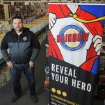 Dave McElroy, owner of Rainbow Sports Cards and Comics, poses for a portrait Tuesday, Nov. 24, 2015, at Rainbow Sports Cards and Comics in Sioux Falls.