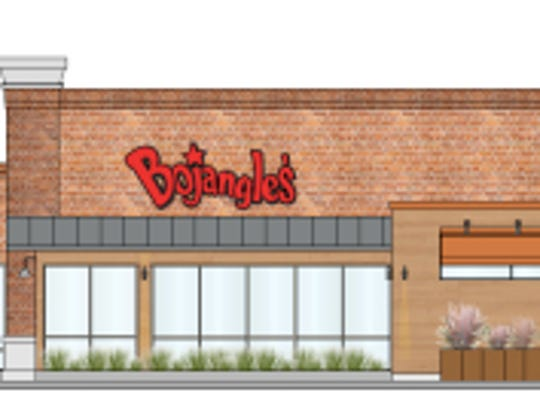 """Bojangles' newly designed restaurants feature Wi-Fi, community tables, table service and a """"Biscuit Theater,"""" that allows customers to watch the biscuit making process."""