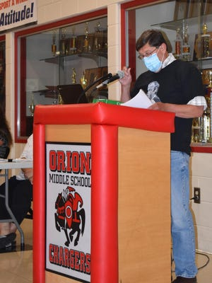 """Eight speakers asked the Orion school board to reinstate Dan Diamond as the varsity wrestling coach on Wednesday, July 15. The last of the eight was Kurt Hessler, whose three sons wrestled for Orion. Hessler wore a shirt that said """"I Stand with Dan."""""""