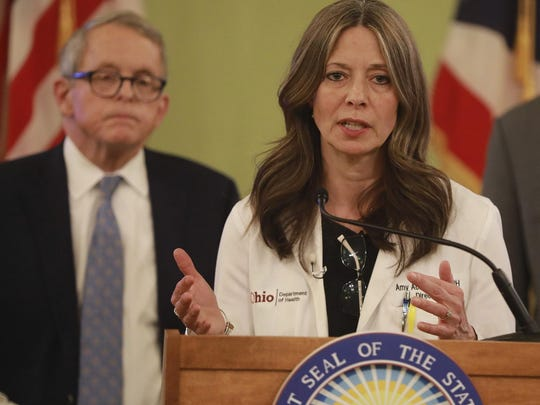 Ohio Health Director Dr. Amy Acton at a coronavirus news conference in March at the Statehouse. Behind her is Ohio Gov. Mike DeWine.