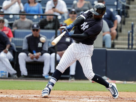 New York Yankees' Didi Gregorius hits a single during