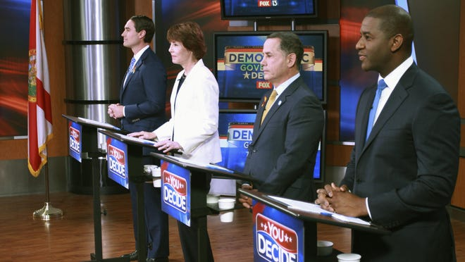 Tallahassee Mayor Andrew Gillum, Miami Beach Mayor Philip Levine, former U.S. Rep. Gwen Graham, and businessman Chris King listen to the moderator April 18 during the first gubernatorial debate in the Democratic primary in Tampa. For much of their second debate, the four contenders were about as civil as can be Saturday night. But mentions of Syrian refugees and a campaign contribution to U.S. Sen. Marco Rubio heated up the debate inside a Largo high school.