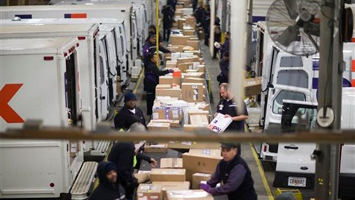In this Dec. 15 file photo, packages are sorted on a conveyer belt before being loaded onto trucks for delivery at a FedEx facility in Marietta, Ga. FedEx, UPS and e-commerce retailers are trying to avoid the problems that occurred last year when severe winter weather and a surge in late orders caused delivery delays.