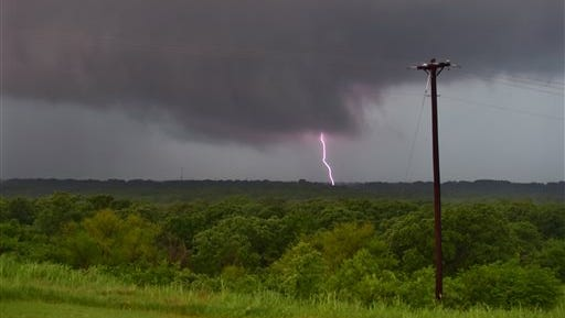 Lightning strikes as storm clouds pass in Denton, Texas, Sunday, May 10, 2015. Parts of several Great Plains and Midwest states were in the path of severe weather, including North Texas, where the National Weather Service said a likely tornado damaged roofs and trees near Denton and torrential rain caused flash flooding.
