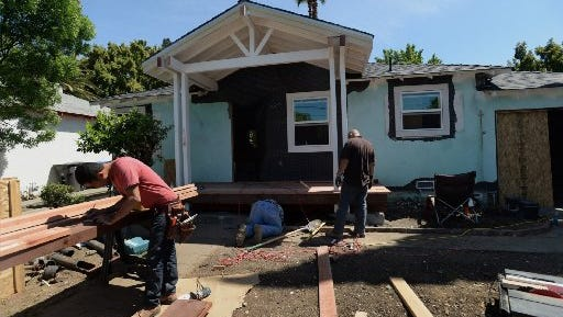 "A crew works on a home being renovated in Concord, Calif., on April 23, 2014. The renovation is on the HGTV show ""Flip-it-to-win-it."""