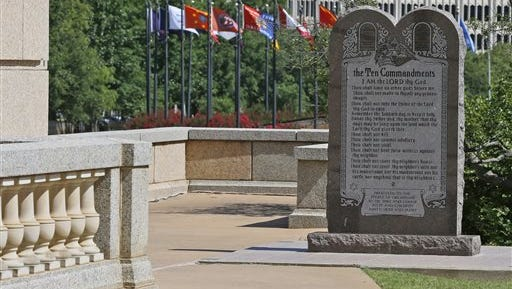 The Ten Commandments monument is pictured at the state Capitol in Oklahoma City, Tuesday, June 30, 2015. Oklahoma's Supreme Court says the monument must be removed because it indirectly benefits the Jewish and Christian faiths in violation of the state constitution.