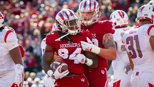 Indiana running back Devine Redding (34) celebrates with offensive lineman Jake Reed (50) after scoring during the first half of an NCAA college football game against Rutgers, Saturday, Oct. 17, 2015, in Bloomington, Ind.  (AP Photo/Doug McSchooler)